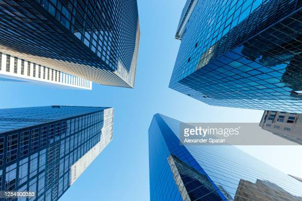 skyscrapers in manhattan downtown, low angle view, new york, usa - wall street lower manhattan stock pictures, royalty-free photos & images