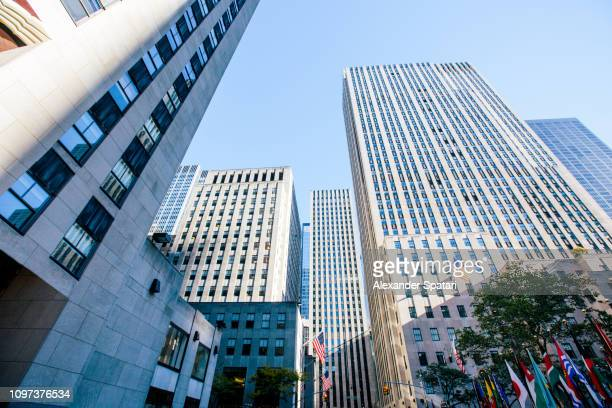 skyscrapers in midtown manhattan, low angle view, new york city - rockefeller center stock pictures, royalty-free photos & images