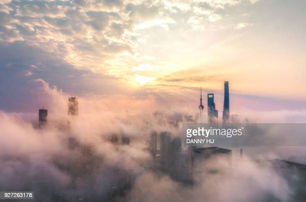 skyscrapers in Shanghai city over the advection fog at sunrise