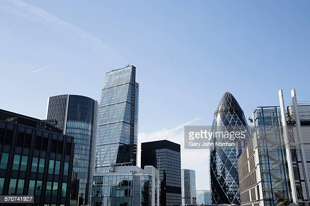 skyscrapers in the finance area of london. - london financial district stock photos and pictures