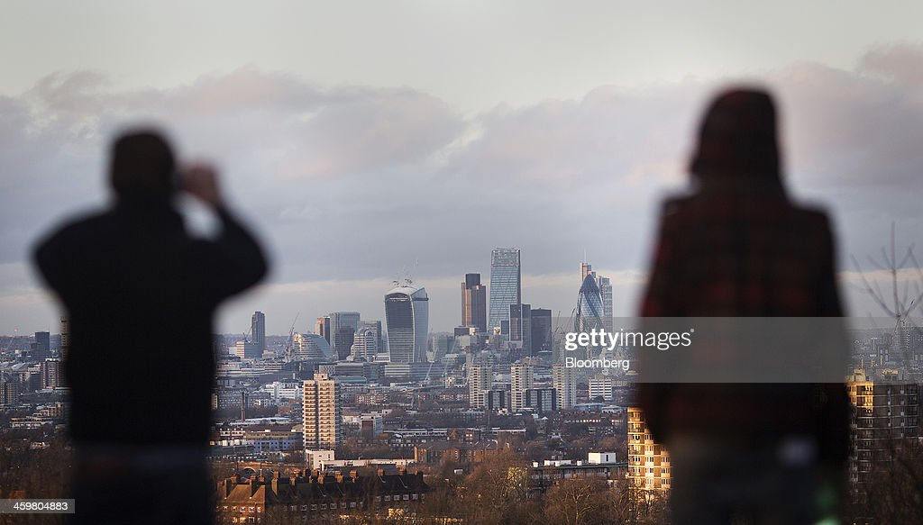 Skyscrapers including 20 Fenchurch Street, center, also known as the 'Walkie-Talkie,' Tower 42 and 30 St Mary Axe, also known as 'the Gherkin,' stand surrounded by commercial office buildings in London, U.K. , on Monday, Dec. 30, 2013. European stocks were little changed amid shortened trading hours for New Year's Eve before American consumer confidence and housing data. U.S. stock-index futures and Asian shares were also little changed. Photographer: Simon Dawson/Bloomberg via Getty Images