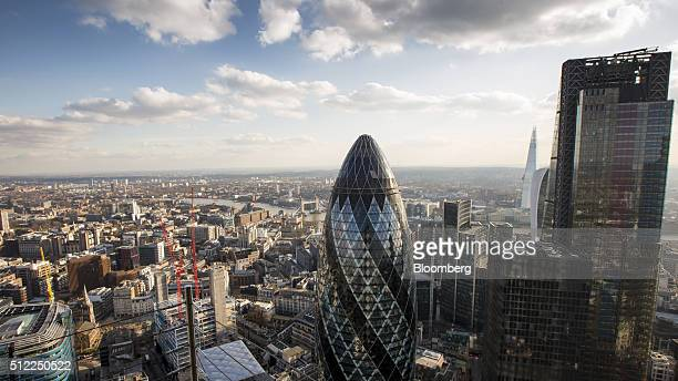 Skyscrapers including the Leadenhall building also known as the Cheesegrater right 30 St Mary Axe also known as the Gherkin center stand surrounded...
