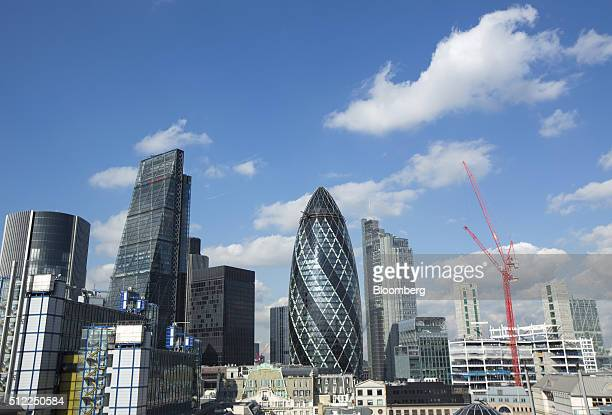 Skyscrapers including the Leadenhall building also known as the 'Cheesegrater' left and 30 St Mary Axe also known as 'the Gherkin' center stand...
