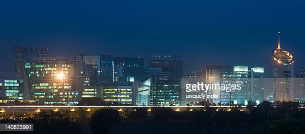 skyscrapers lit up at night, gurgaon, haryana, india - haryana stock pictures, royalty-free photos & images