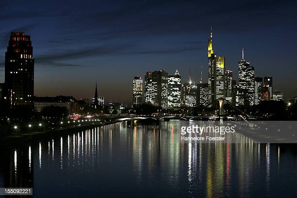 Skyscrapers many of them belonging to leading European banks stand illuminated in the city center on October 31 2012 in Frankfurt Germany Frankfurt...