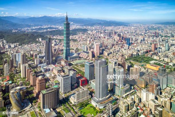 skyscrapers of a modern city with overlooking perspective under blue sky in taipei, taiwan - taiwan stock photos and pictures