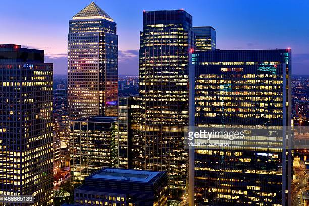 skyscrapers of canary wharf at twilight - canary wharf stock photos and pictures