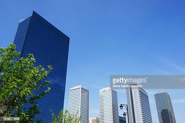 skyscrapers of osaka business district - 大阪ビジネスパーク ストックフォトと画像