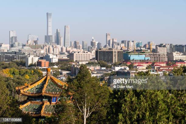 skyscrapers of the beijing business and financial district contrast with an ancient pagoda in beijing in china capital city - beijing stock pictures, royalty-free photos & images