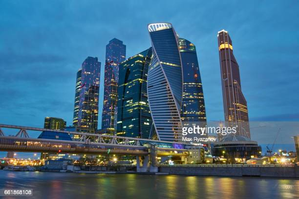 skyscrapers of the business district at dusk - moscow international business center stock photos and pictures