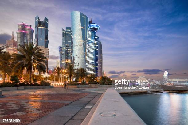 skyscrapers on shore at dusk - doha stockfoto's en -beelden