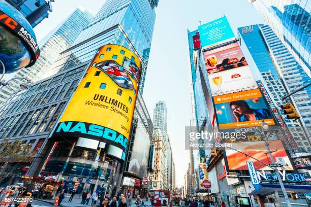 skyscrapers on times square on a sunny morning, new york city, usa - broadway manhattan stock photos and pictures