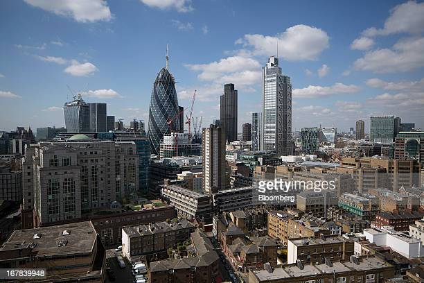 Skyscrapers rise from the City of London left to right 20 Fenchurch Street also known as the 'WalkieTalkie' the Swiss Re building also known as 'the...