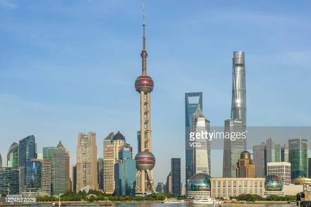 Skyscrapers stand at the Pudong Lujiazui Financial District on May 12, 2020 in Shanghai, China.