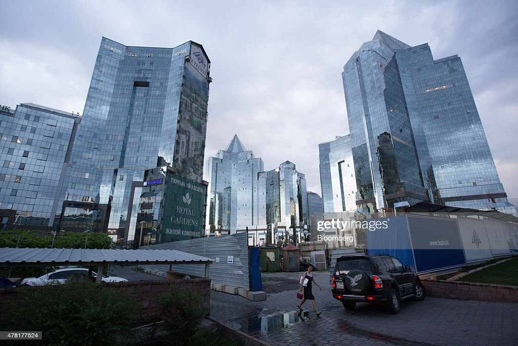 Skyscrapers stand in the Nurly Tau business center in Almaty, Kazakhstan, on Monday, June 22, 2015. Kazakhstan completed its negotiations to become the 162nd member of the World Trade Organization, after 19 years of negotiations, and hopes to fully ratify its accession by Oct. 31. Photographer: Andrey Rudakov/Bloomberg via Getty Images
