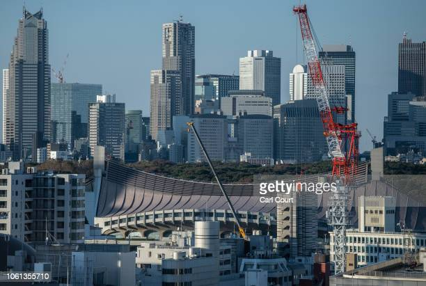 Skyscrapers surround the curved roof of Yoyogi National Stadium on November 14 2018 in Tokyo Japan The 13291 seat stadium is set to host handball...