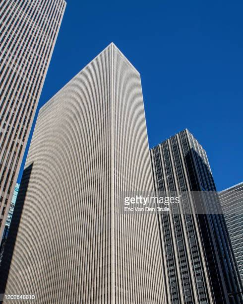 skyscrappers against blue sky - eric van den brulle stock pictures, royalty-free photos & images