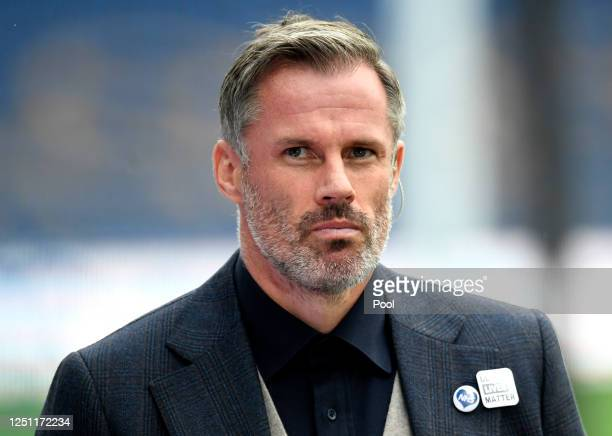 Skysports pundit Jamie Carragher looks on during the Premier League match between Everton FC and Liverpool FC at Goodison Park on June 21, 2020 in...