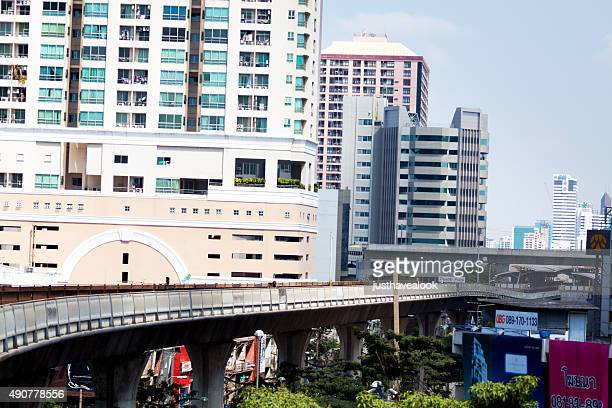 skytrain bridge and station between modern buildings - between stock pictures, royalty-free photos & images