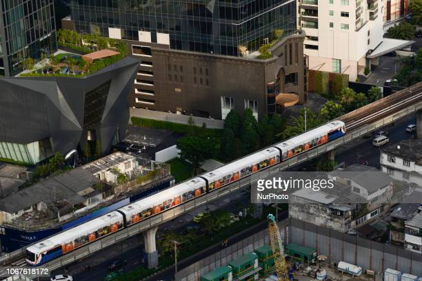 A skytrain passes over vehicles on road in Bangkok Thailand 02 December 2018