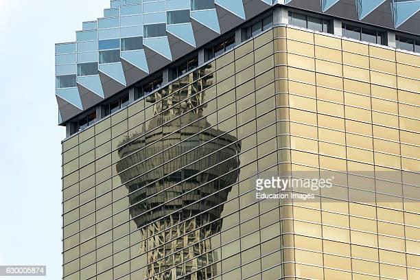 Skytree Tower reflected in Asahi Breweries headquarters building in Tokyo Japan