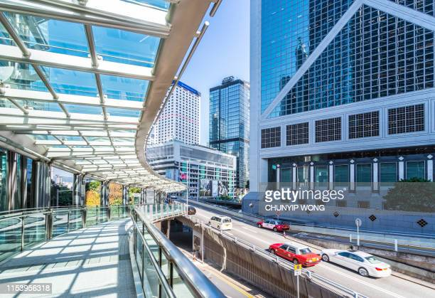 skywalk toward central district of hong kong - central stock pictures, royalty-free photos & images
