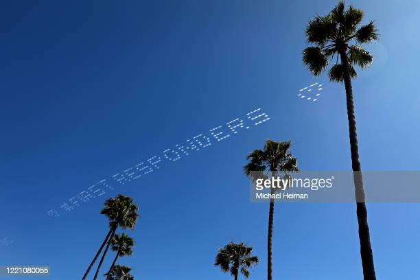 Skywriting reading #firstresponders and a heart is seen above the Newport Beach Pier on April 25 2020 in Newport Beach California Southern California...