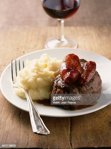Slab of beef with confit shallots and mashed potatoes