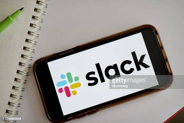 Slack signage on a smartphone in the Brooklyn Borough of New York, U.S., on Tuesday, Dec. 1, 2020. Salesforce.com's expected purchase of Slack...