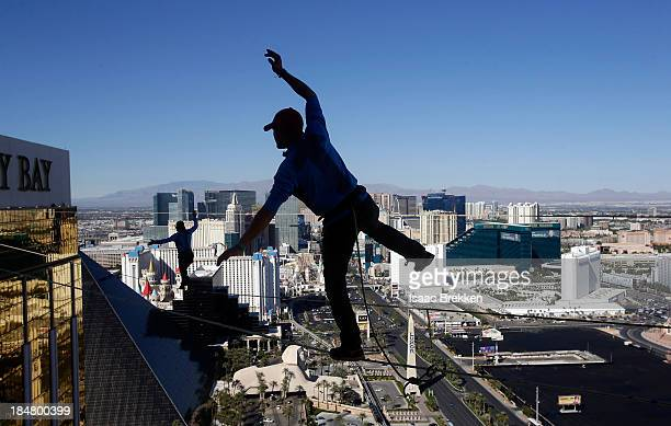 Slackline athletes perform on an urban highline at Mandalay Bay Resort and Casino on October 16 2013 in Las Vegas Nevada