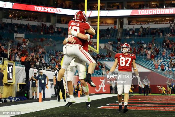 Slade Bolden of the Alabama Crimson Tide celebrates a five yard touchdown with Mac Jones during the third quarter of the College Football Playoff...