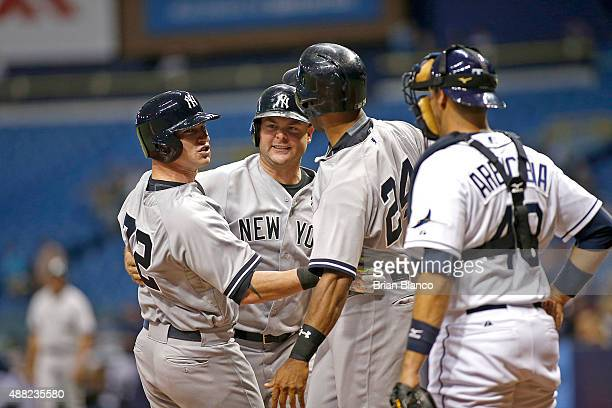 Slade Heathcott of the New York Yankees celebrates his threerun home run with teammates Brian McCann and Chris Young as catcher JP Arencibia of the...