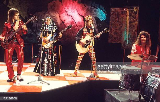 Slade perform on BBC TV show Top Of The Pops London LR Jim Lea Dave Hill Noddy Holder Don Powell