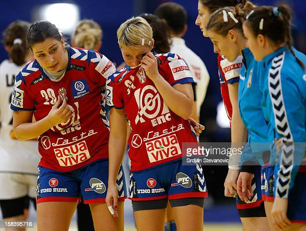 Sladjana PopLazic and Ivana Milosevic looks dejected after Serbia lost the match against Montenegro the Women's European Handball Championship 2012...