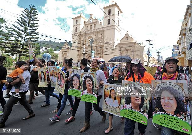 Slain Honduran environmentalist Berta Caceres posters are carried during a International Women's day demonstration in Tegucigalpa on March 08 2016...