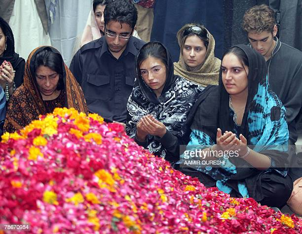 Slain Pakistani Premier Benazir Bhutto's son Bilawal daughters Bakhtawar Asifa and Bhuttos younger sister Sanam Bhhutto pray at her graveside in the...