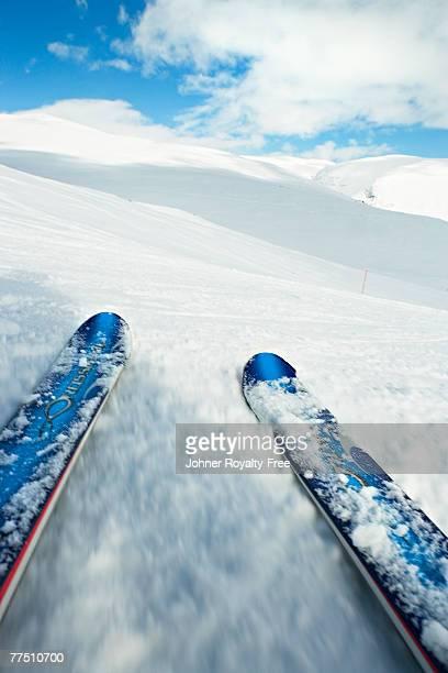 slalom skis in a ski slope. - ski slalom stock-fotos und bilder