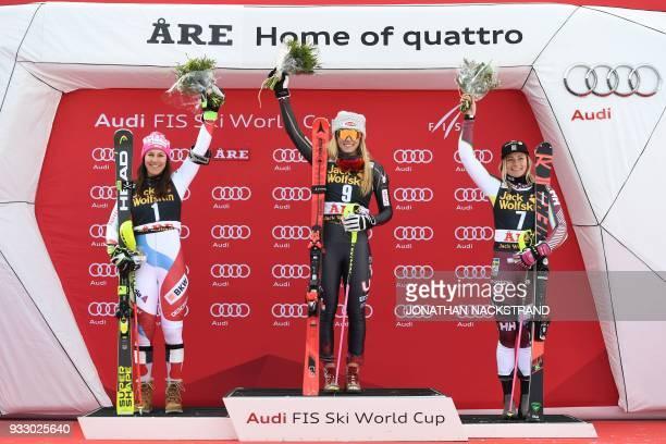 Slalom World Cup overall winners Wendy Holdener of Switzerland Mikaela Shiffrin of the US and Frida Hansdotter of Sweden celebrate on the podium...