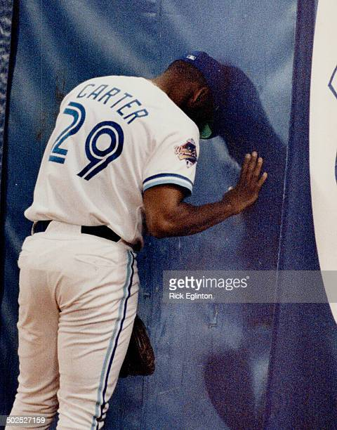 Slam dance Blue Jays' outfielder Joe Carter leans his head against the wall last night after Atlanta's Lonnie Smith smacked a grand slam homer to win...