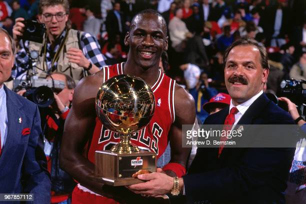 Slam dunk contest winner Michael Jordan of the Chicago Bulls receives trophy during the 1988 Slam Dunk Contest circa 1988 at Chicago Stadium in...