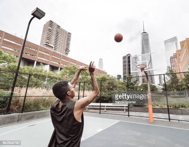 slam dunk in new york city - making a basket scoring stock photos and pictures