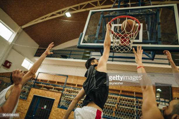 slam dunk on basketball match! - basketball team stock pictures, royalty-free photos & images