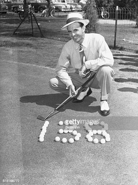 """""""Slammin"""" Sam Snead, of Hot Springs, Virginia, grins as he displays his medalist score, in the qualifying round of the 1941 PGA championship..."""