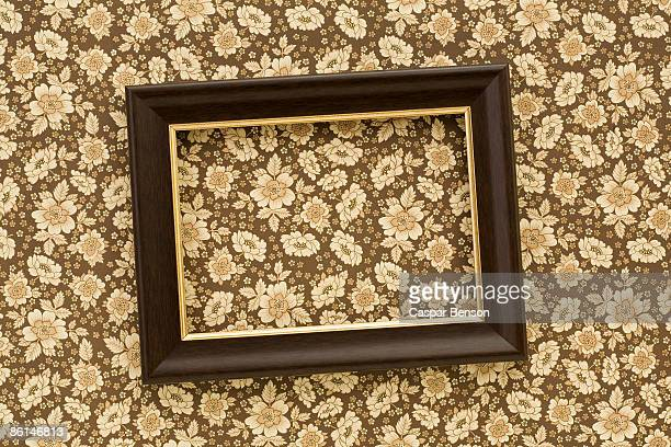 a slanted picture frame hanging on a wall - torto imagens e fotografias de stock