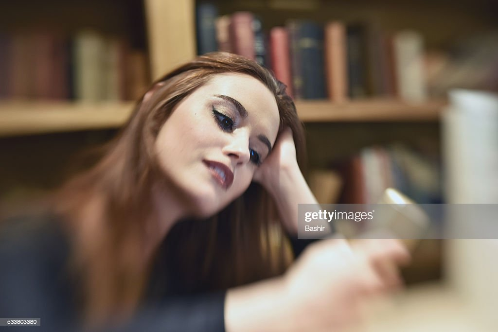 slanted portrait of a woman engrossed on her mobile phone : Foto stock