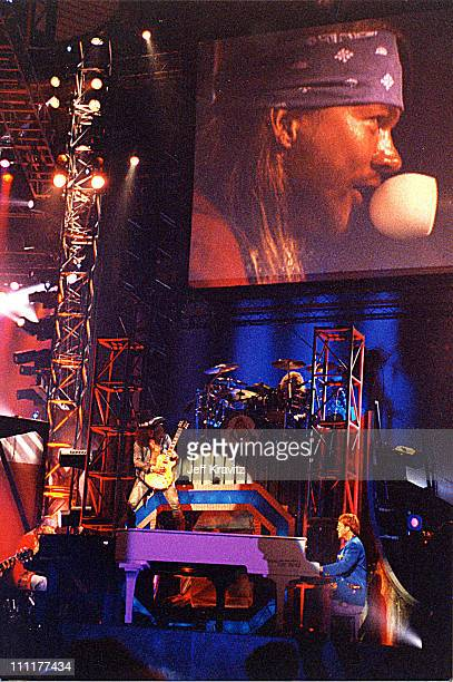 Slash and Axl Rose Guns N' Roses perform with Elton John