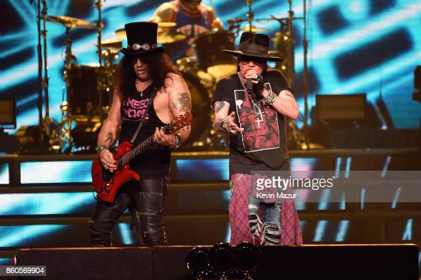 """Slash and Axl Rose of Guns N' Roses perform onstage during the """"Not In This Lifetime..."""" Tour at Madison Square Garden on October 11, 2017 in New..."""