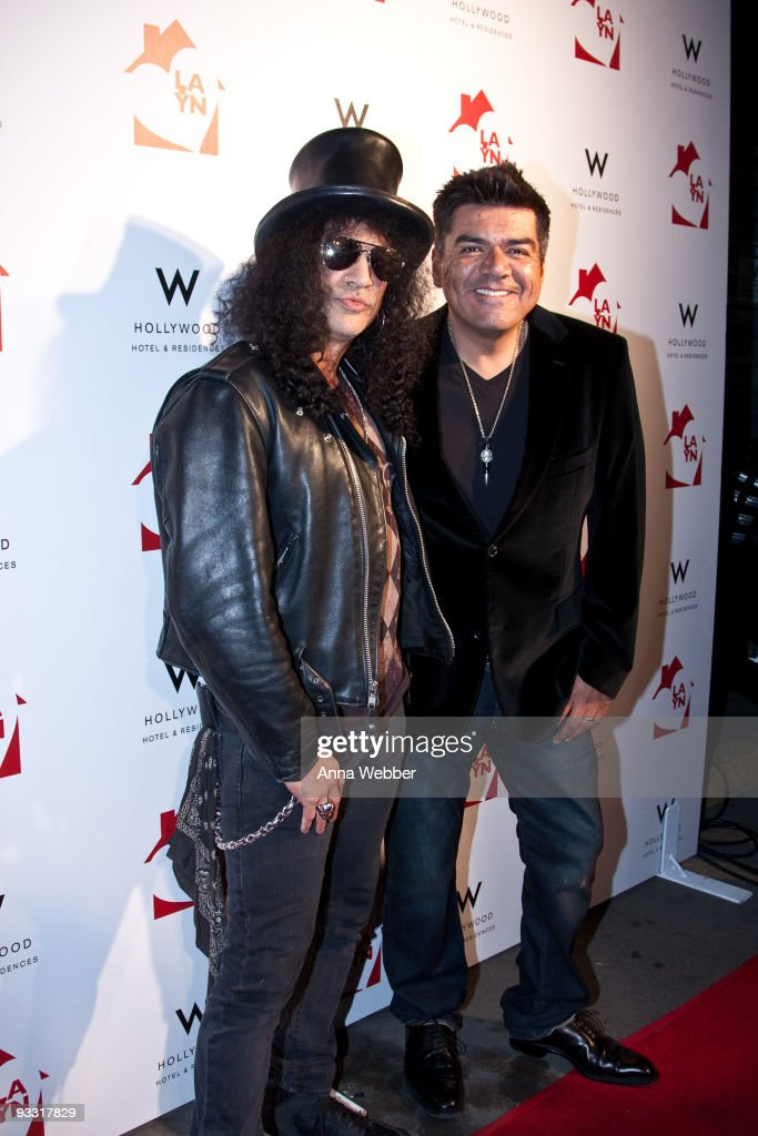 Slash and George Lopez arrive at Los Angeles Youth Network Benefit Rock Concert at the Avalon on November 22, 2009 in Hollywood, California.