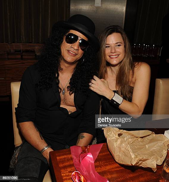 Slash and Gilligan Stillwater attend Slash's birthday dinner at Stack Restaurant at The Mirage Hotel and Casino on July 24, 2009 in Las Vegas, Nevada.