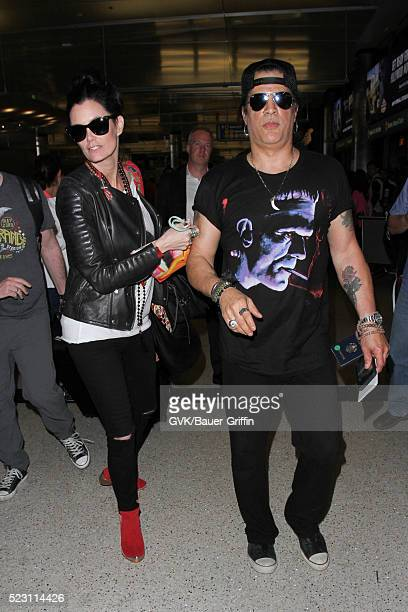 Slash and Meegan Hodges are seen at LAX on April 21 2016 in Los Angeles California